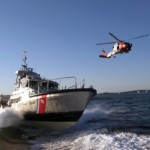 Coast Guard boat and helicopter in Gloucester harbor
